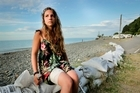 French tourist Laura Vidalled sits on a sea wall at Clifton Motorcamp close to where she was hit by a stingray's barb. News. 8 March 2016. Hawke's Bay Today photograph by Warren Buckland