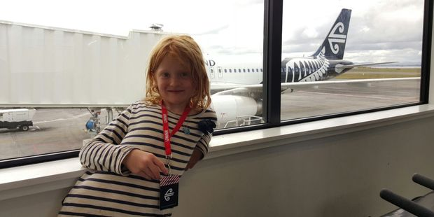 Isla Taylor waits to board her flight at Auckland domestic terminal. Photo / Winston Aldworth