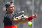 Rotorua's Jesse Galvin-Dawson fires back a forehand during his team's grand final victory against Whakatane on Saturday. PHOTO/STEPHEN PARKER