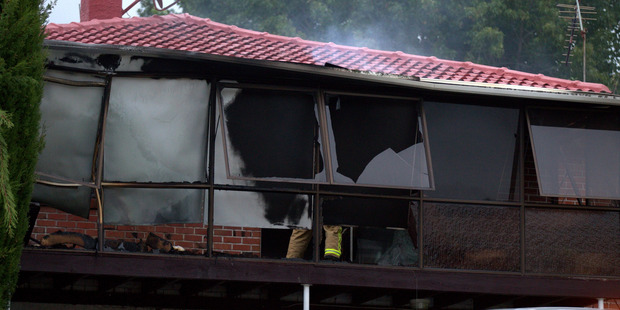 A house was damaged by fire tonight. Photo / Dean Purcell