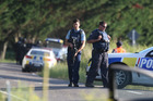 Armed Police at the scene of a shooting on Onepu Springs Road near Kawerau. Rotorua Daily Post Photograph by Ben Fraser