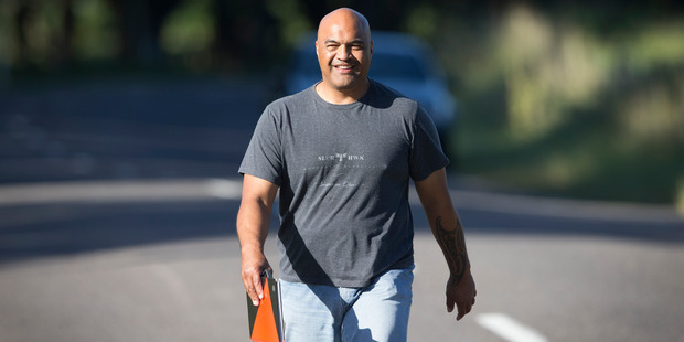 Taupo Police area Commander Inspector Warwick Morehu walks to inform the family and friends that Rhys Warren is in the car behind him, safe and in custody. Photo / Nick Reed