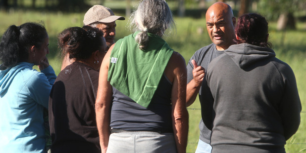 Inspector Warwick Morehu speaks with family members of the arrested man yesterday. Photo/Ben Fraser