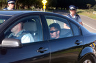 The alleged gunman leaves the scene in an unmarked police car yesterday. Photo / Ben Fraser