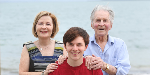 Jamie Beaton with his mother Paula Beaton and grandfather John Beaton at St Heliers beach in Auckland. Photo / Doug Sherring