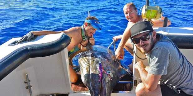 Byron Milne (left) and a Striped marlin that he caught off the cost of Western Australia. Photo / Facebook