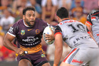 Sam Thaiday of the Broncos looks to take on the defence during the round two NRL match between the Brisbane Broncos and the New Zealand Warriors. Photo / AP.