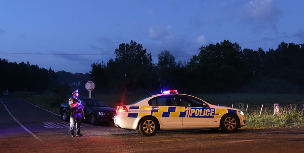 The police cordon on Onepu Rd near Kawerau after four police were shot. Photo / Alan Gibson