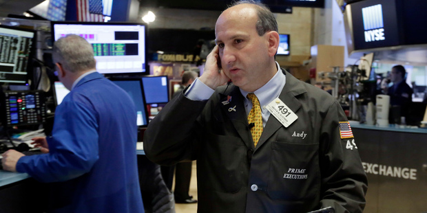 Trader Andrew Silverman works on the floor of the New York Stock Exchange. File photo / AP