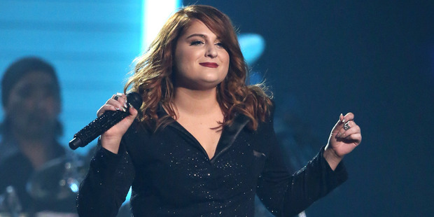 Meghan Trainor felt bad next to her 'tiny' dancers in a new video.