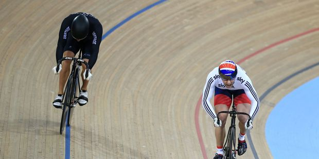 Great Britain's Jason Kenny, right, on his way to winning his second race against New Zealand's Sam Webster, during the men's sprint quarter final's race. Photo / AP.