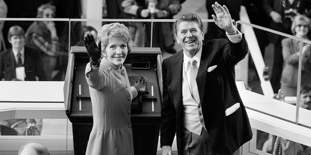 President Ronald Reagan and first lady Nancy Reagan wave to onlookers at the Capitol building. Photo / AP