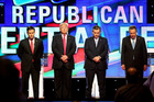 Republican presidential candidates (L-R) Marco Rubio, Donald Trump, Ted Cruz and John Kasich stand for a moment of silence for former first lady Nancy Reagan. Photo / AP