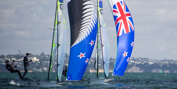 FLAG CHOICE: New Zealand 49er sailors Peter Burling and Blair Tuke test a new sail in the Hauraki Gulf on Tuesday that has been made with the silver fern flag design, ahead of the 2016 Rio Olympics.PHOTO/GREG BOWKER