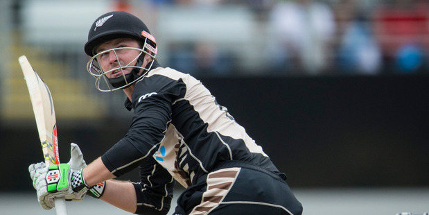 Black Cap Colin Munro clubbed 67 off 34 balls with seven sixes against Sri Lanka in Mumbai yesterday. Photo / Jason Oxenham.