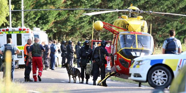 Police gather at the Kawerau siege. Photo/Ben Fraser