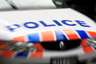 A 29 year-old man is in custody following an incident where a woman was dragged violently into a car.