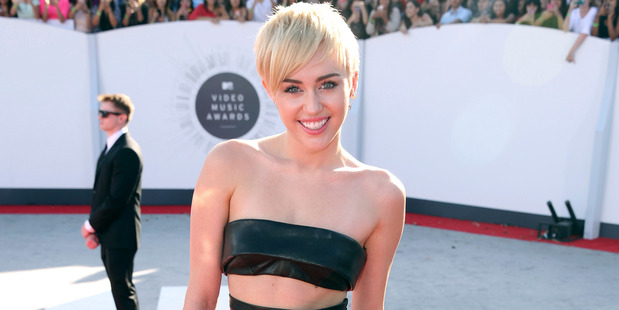 Miley Cyrus tries to put a stop to the hate around Kim Kardashian's nude selfie.