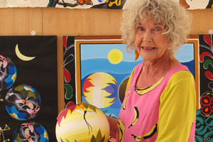 """""""Walking rainbow"""" Valerie Hutton in her studio with work inspired by 15 years on remote Pacific islands. PHOTO/PETER DE GRAAF"""