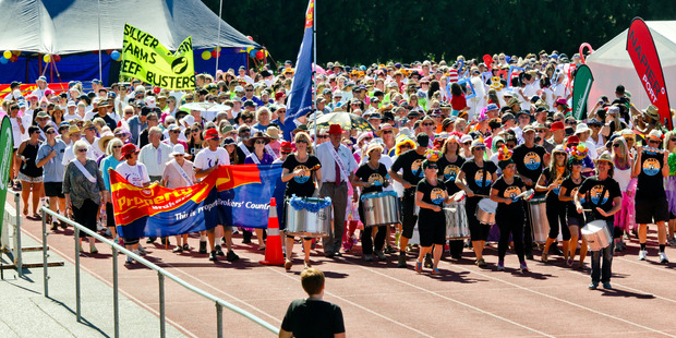 LAPPING IT UP: Banners and drumbeats led the way for the more than 1500 people who took part in Saturday's Relay For Life. PHOTO/Warren Buckland