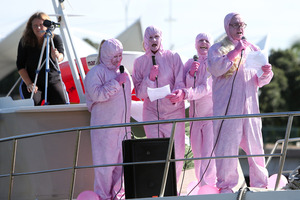 The singing protesters serenaded Prime Minister John Key from a boat.