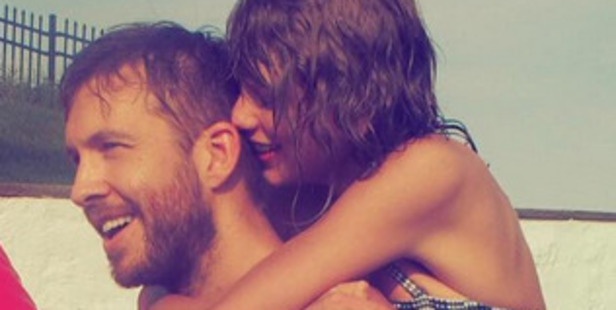 Taylor Swift and Calvin Harris during a beach holiday together.