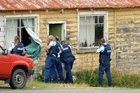 Armed police discovered a dead woman inside the Seacliff house. Photo / Otago Daily Times