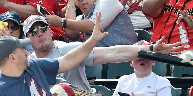 A fan saves a bat from hitting a young kid at a baseball game. Photo Christopher Horner  via Twitter/@Hornerfoto1