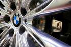 A BMW logo on the wheel hub of a BMW 7-Series in Munich in 2015. Photo / Krisztian Bocsi