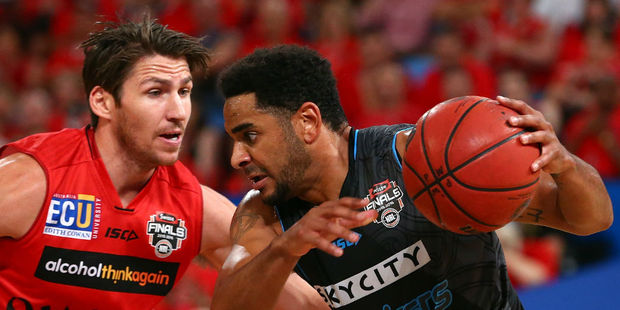 Corey Webster tries to drive past Damian Martin. Photo / Getty