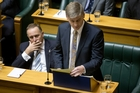 Bill English delivers his 2015 Budget, in which KiwiSaver's $1000 sign-on bonus was axed. Picture / Mark Mitchell