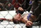 Conor McGregor recovers shortly after a second round-submission to Nate Diaz. Photo / AP
