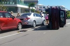 A car has been turned on its side after a collision on Marine Parade in Mount Maunganui. Photo/Casey Ireland