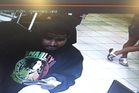 A CCTV image of a man using Ria Pou's credit card.