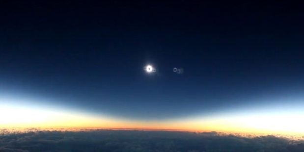 """The total eclipse got """"eclipse geeks"""" on the flight extremely excited. Photo / YouTube"""