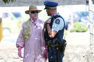 A police officer chats with a protester.