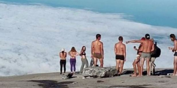 A group of tourists caused controversy after posing for a nude photo on top of Mount Kinabalu in Malaysia last year. Photo / Youtube