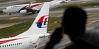 The wife of MH370 captain Zaharie Ahmad Shah has been questioned about his state of mind prior to the flight. Photo / AP