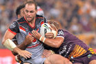 Simon Mannering is tackled by Brisbane Broncos defenders. Photo / Getty