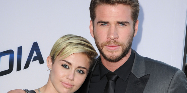 Miley Cyrus has taken a step back from the spotlight to work on her relationship with Liam Hemsworth. Photo / Getty