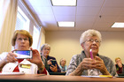 Residents at Westminster at Lake Ridge, a senior living community in Prince William County, United States, listen as Christian Magnuson, 16, teaches them to use their smartphones. Photo / Katherine Frey