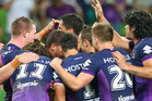 The Storm players celebrate a try in their round one win over the Dragons. Photo / Getty