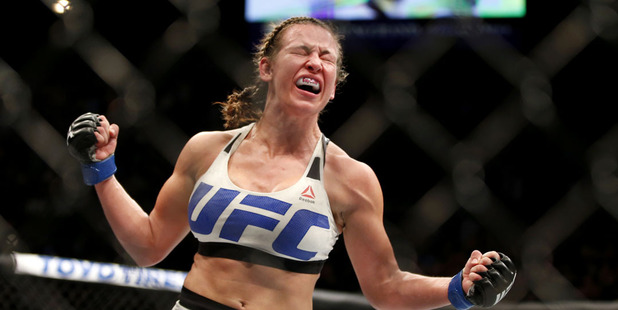 Miesha Tate celebrates victory over Holly Holm in their UFC 196. Photo / AP