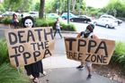 Protesters outside the TPP roadshow. Photo / Michael Craig