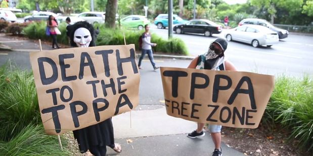 Loading Protesters outside the TPP roadshow. Photo / Michael Craig