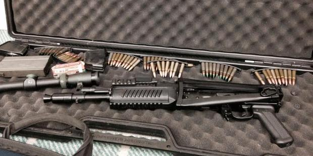 A stash of high powered military rifles including 14  AK47's and M16's were found. Photo / Supplied via Police