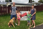 Vanessa Jones, pictured with husband Mike, kids Ella and Carter and dog Zeus, sold their house in two weeks.