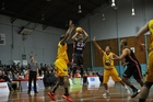 Jamie Adams of the Rams shots over Marcus Johnson of the Taranaki MountainAirs. Photo / Photosport