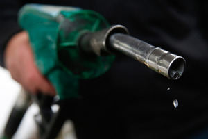 Unleaded fuel drips from a petrol pump. Photo / Bloomberg