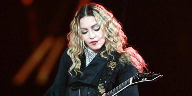 Madonna says she would never perform while drunk or high, but she does act like it sometimes. Photo/AP
